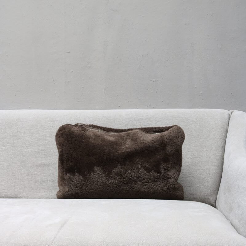 pillow in chocolate colored lambskin with zipper from Journey by Oliver Gustav