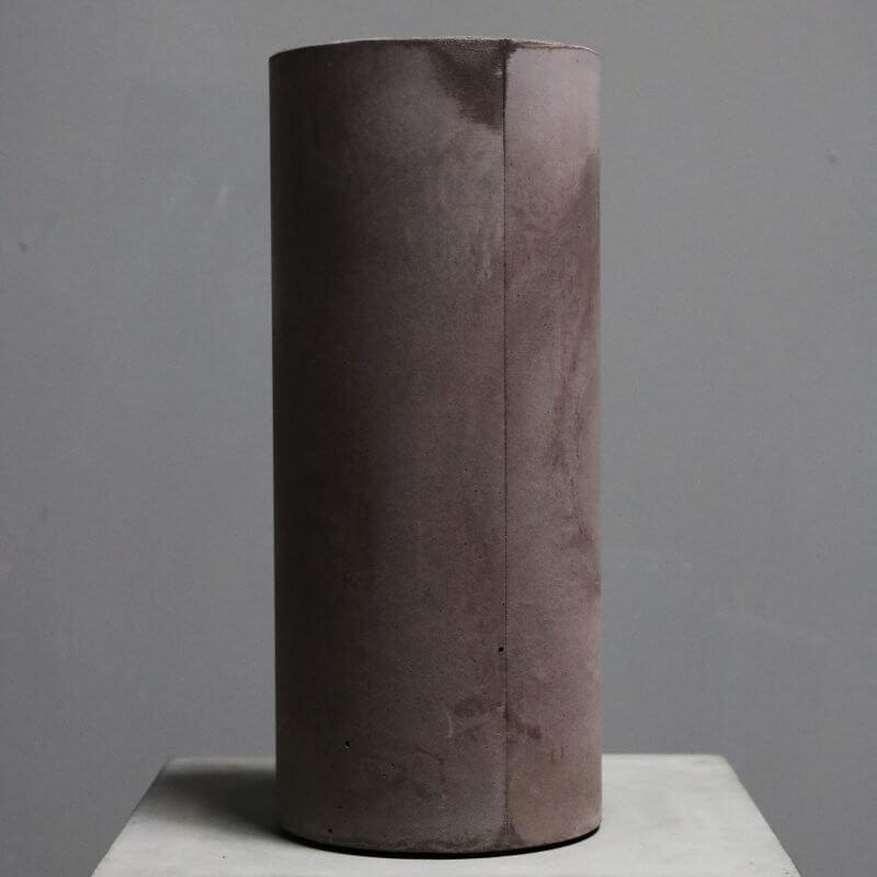 cylindrical vase made in concrete in tan color by dutch designer michael verheyden