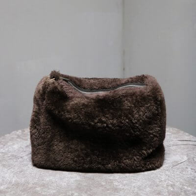 Toiletry bag in chocolate colored lambskin from Journey by Oliver Gustav