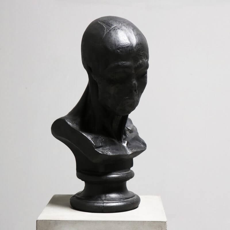 sculpture of head in bronze by Oliver Gustav