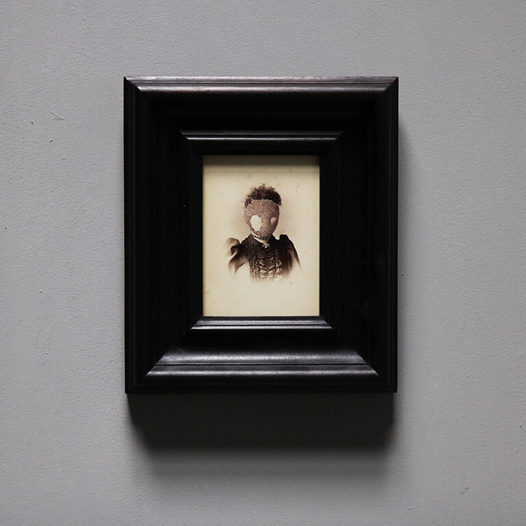 Unique art piece by artist Tom Butler Gouache on old photograph in stained oak frame