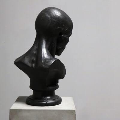 Sculpture of head in bronze by Oliver Gustav