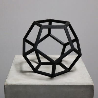 Beautiful geometrical model in burnt black wood dodecahedron