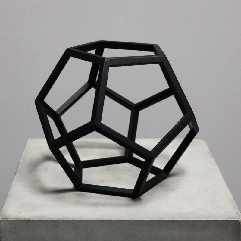 Beautiful geometrical model in burnt black wood for interior design decoration