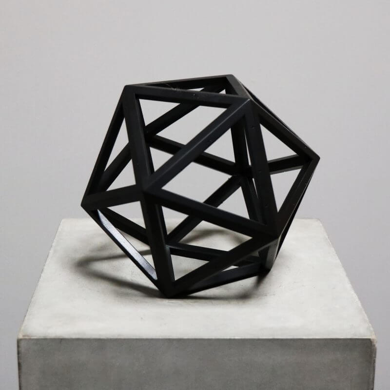 Beautiful geometrical model in burnt black wood for interior design decoration - icosahedron