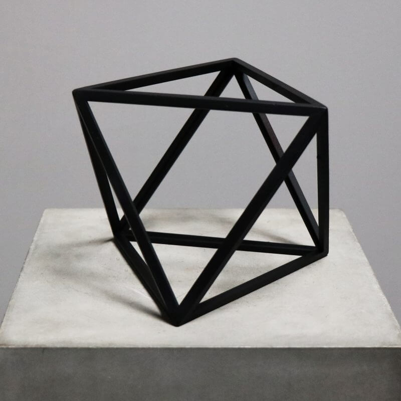 Beautiful geometrical model in burnt black wood