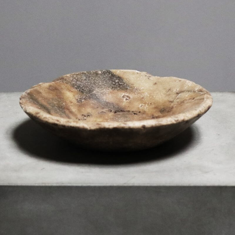 Unique plate or bowl carved in stone