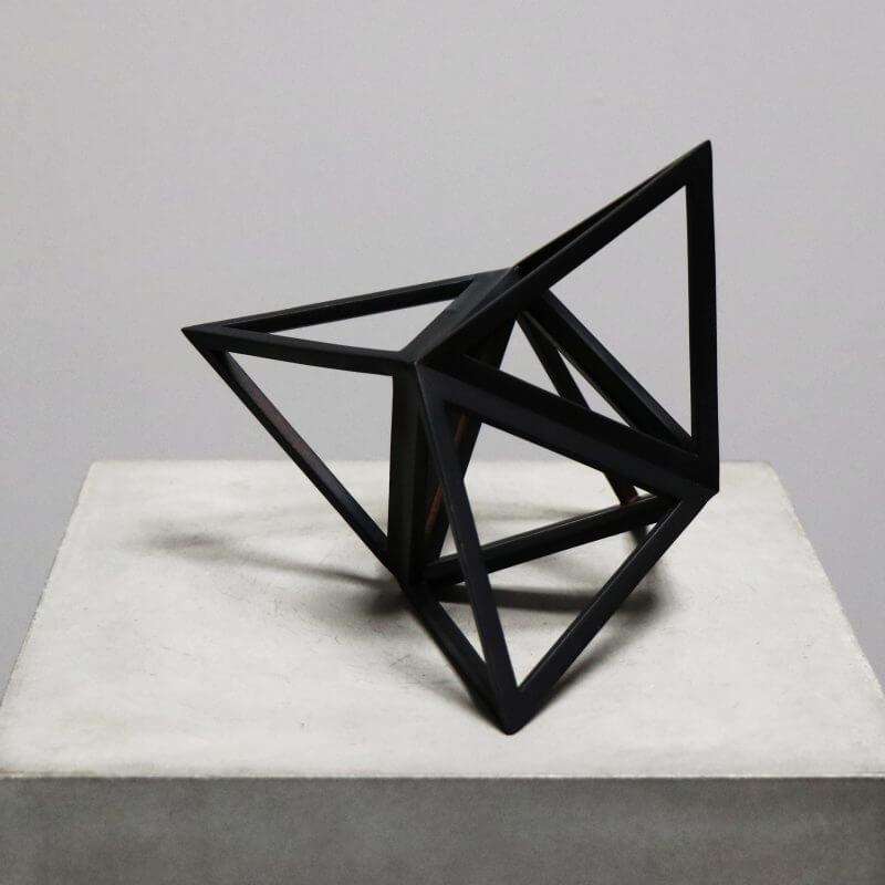 Beautiful geometrical model in burnt black wood for interior design decoration