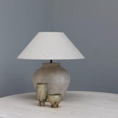 Beige terracotta lamp with a hemp lamp shade