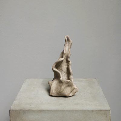 """Ceramic sculpture by Danish artist Ursula Nistrup. The piece is titled """"Wild Gospel"""" and is a part of a series of 3 ceramic works made in gray clay with lava parts."""