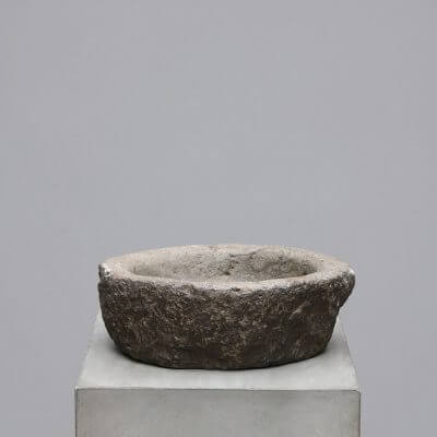Oval stone bowl carved in solid stone