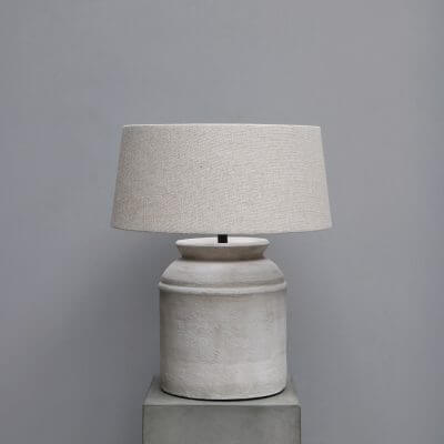 Cylindrical terracotta lamp with a lamp shade made in hemp fabric