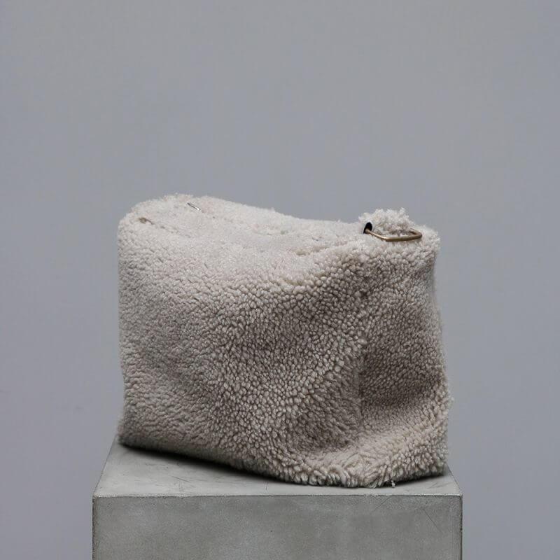 Toiletry bag in lambskin in grey by journey by oliver gustav