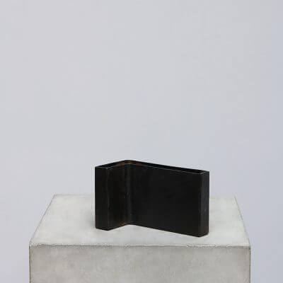 Minimalistic angled vessel in iron. To be used as a vase for dried flowers or storage of small items.
