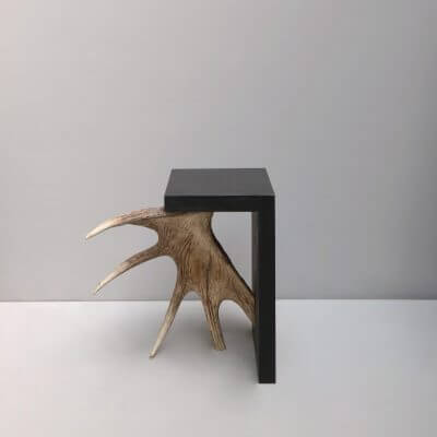 Stag T side table in blackend plywood and moose antler by designer Rick Owens.